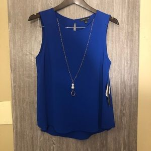 Blue blouse with necklace